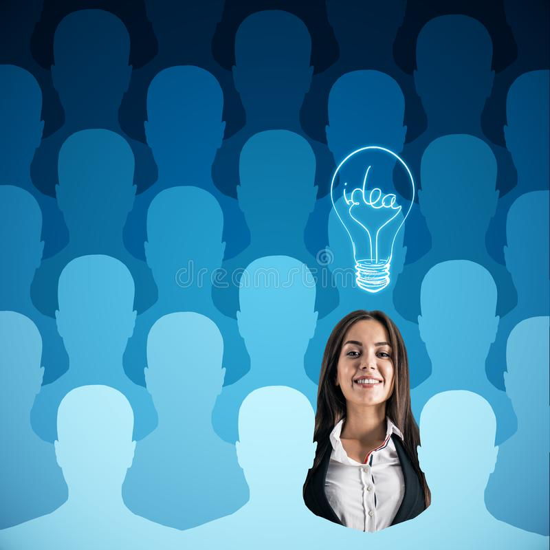 Human resources, idea and talent concept. Abstract blue row of people silhouettes with attractive happy young businesswoman and light bulb. Human resources, idea royalty free illustration