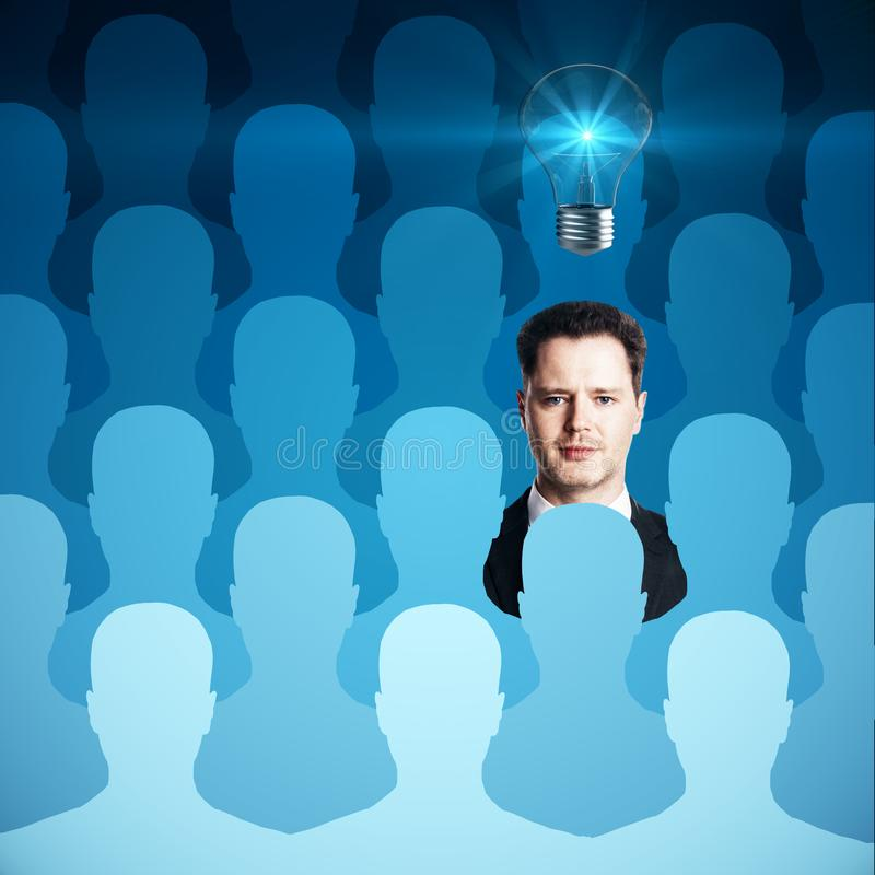 Human resources, idea and talent concept. Abstract blue row of people silhouettes with handsome businessman and light bulb. Human resources, idea and talent royalty free illustration