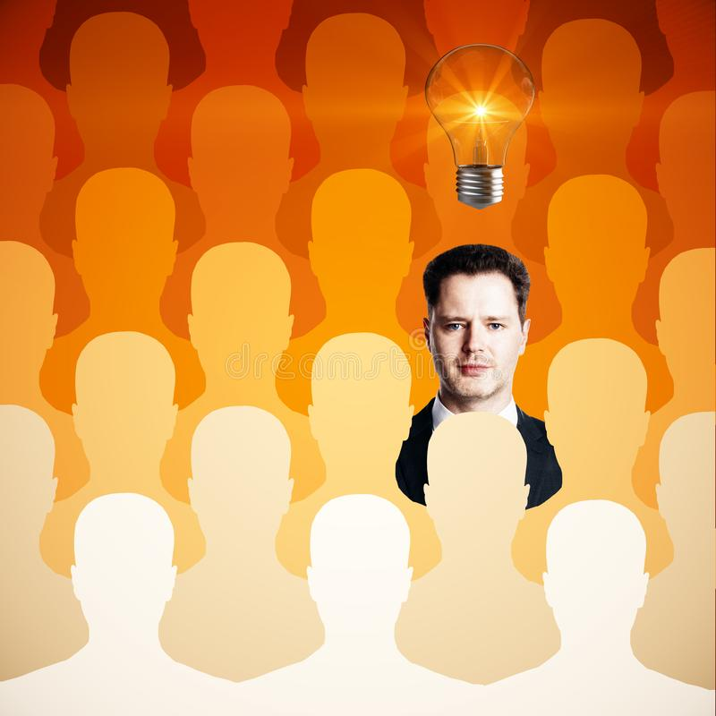 Human resources, idea and talent concept. Abstract orange row of people silhouettes with handsome businessman and light bulb. Human resources, idea and talent royalty free illustration