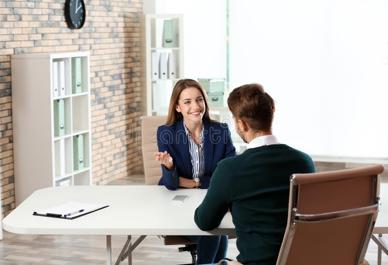 Human resources manager conducting job interview with applicant. In office royalty free stock images