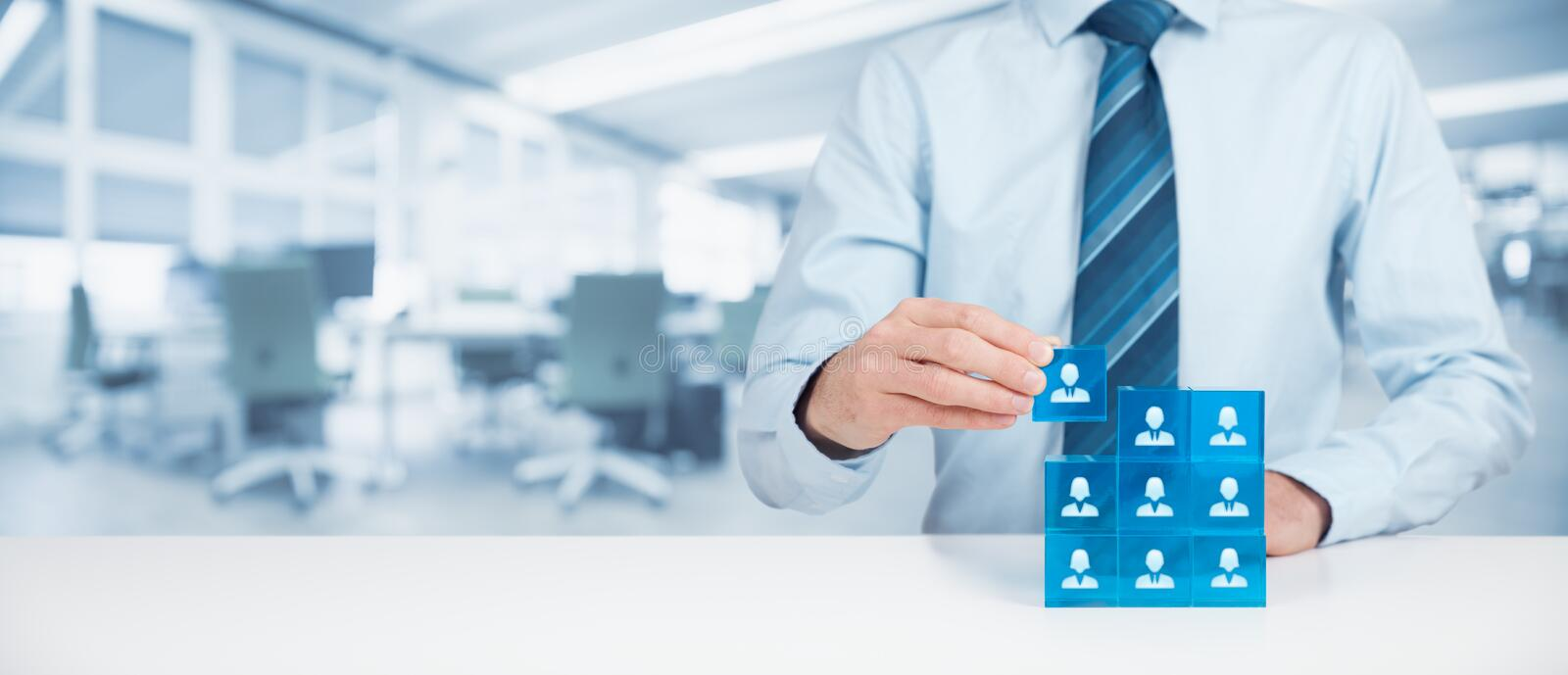 Human resources. Social networking, assessment center concept, personal audit or CRM concept - recruiter complete team by one person. Employees are represented royalty free stock photos