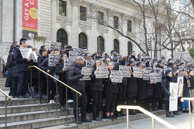 Human Rights Activists Protest on the Steps of the New York Public Library against Coercive Conversion Programs. Human RIghts Activists Protest on the Steps of stock photos