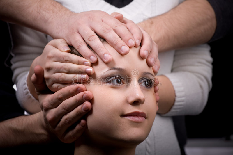 Human robot science fiction concept. Many hands holding a head of young woman. Human robot science fiction concept stock photography