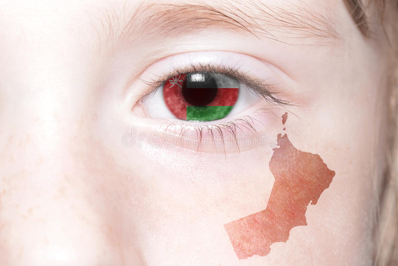 Human& x27;s face with national flag and map of oman. royalty free stock photography