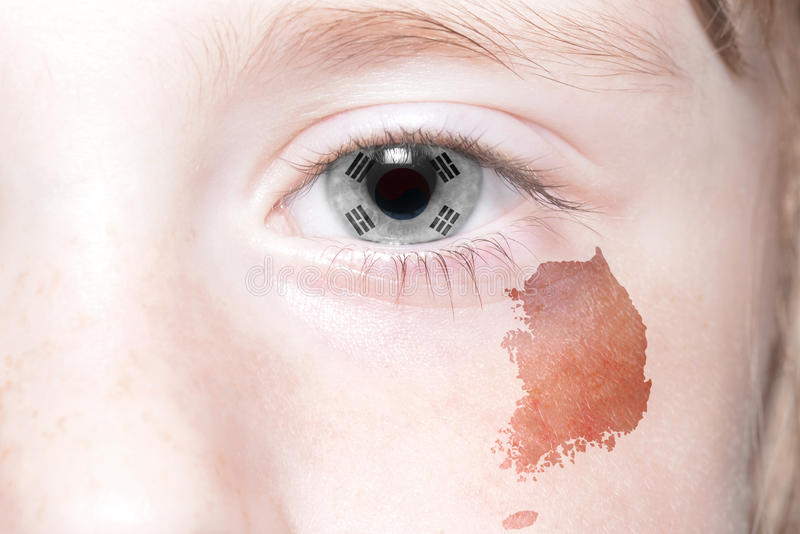 Human& x27;s face with national flag and map of south korea. stock photos