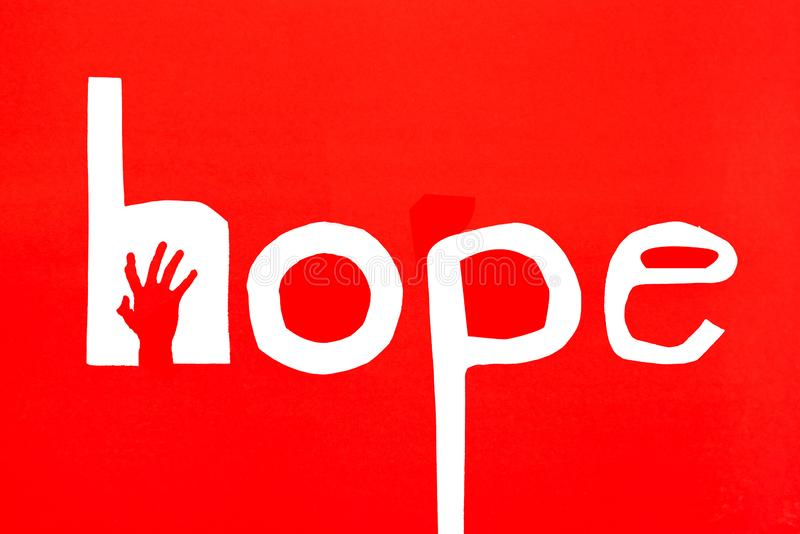 Human`s hand reaching out for help on red background stock photo