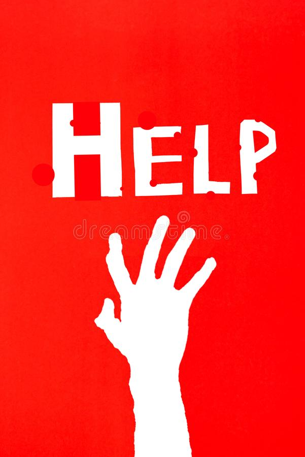 Human`s hand reaching out for help on red background with letter stock photos