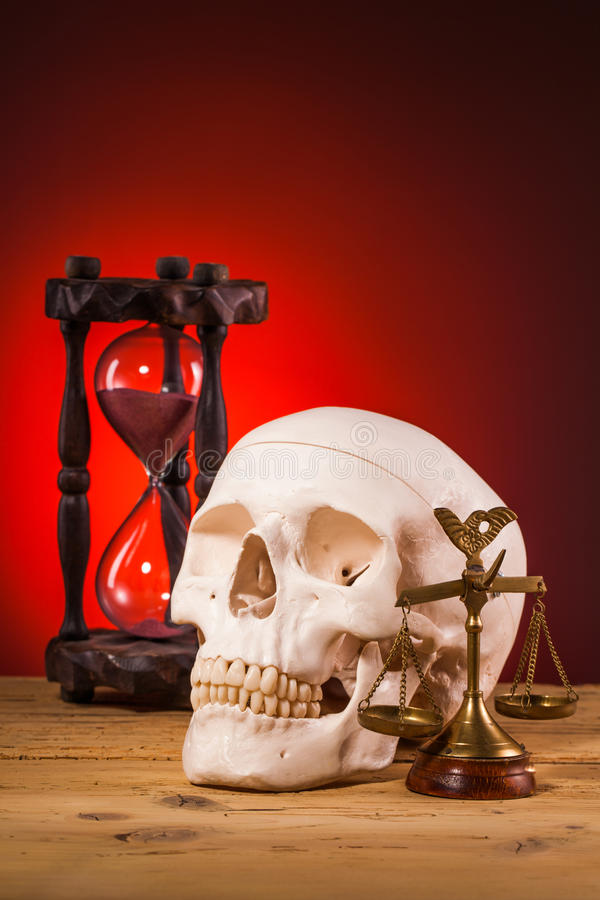 Human scull and scales of justice royalty free stock photo