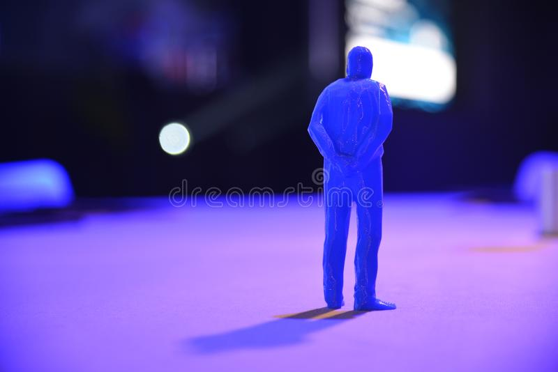 Human shape figure and shadow in blue light. Selective focus royalty free stock photography