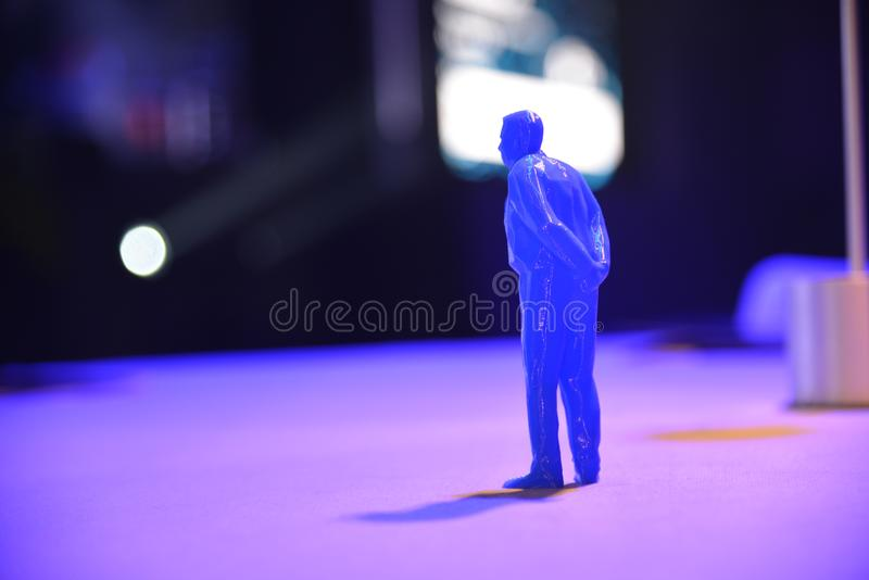 Human shape figure and shadow in blue light. Selective focus royalty free stock images