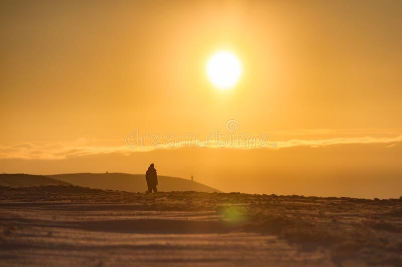 Human silhouette at sunrise. stock photo