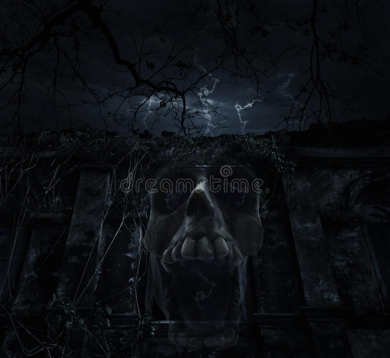 Human skull blend with old ancient castle over dead tree and cloudy sky, Spooky background, Halloween concept stock image