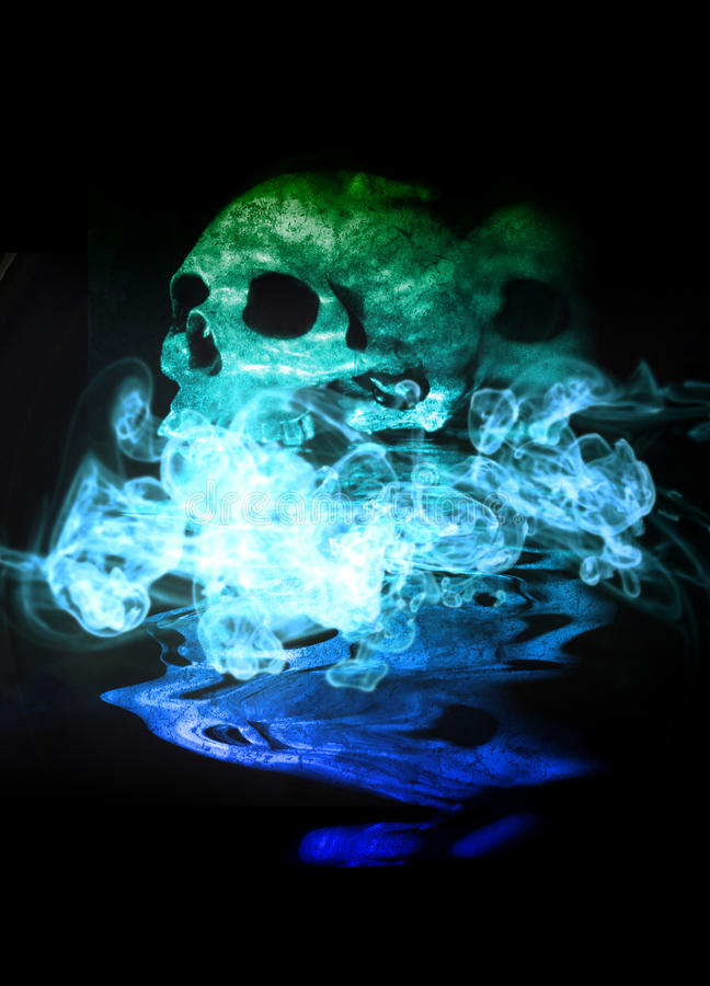 Human skull, reflection and smoke stock photos