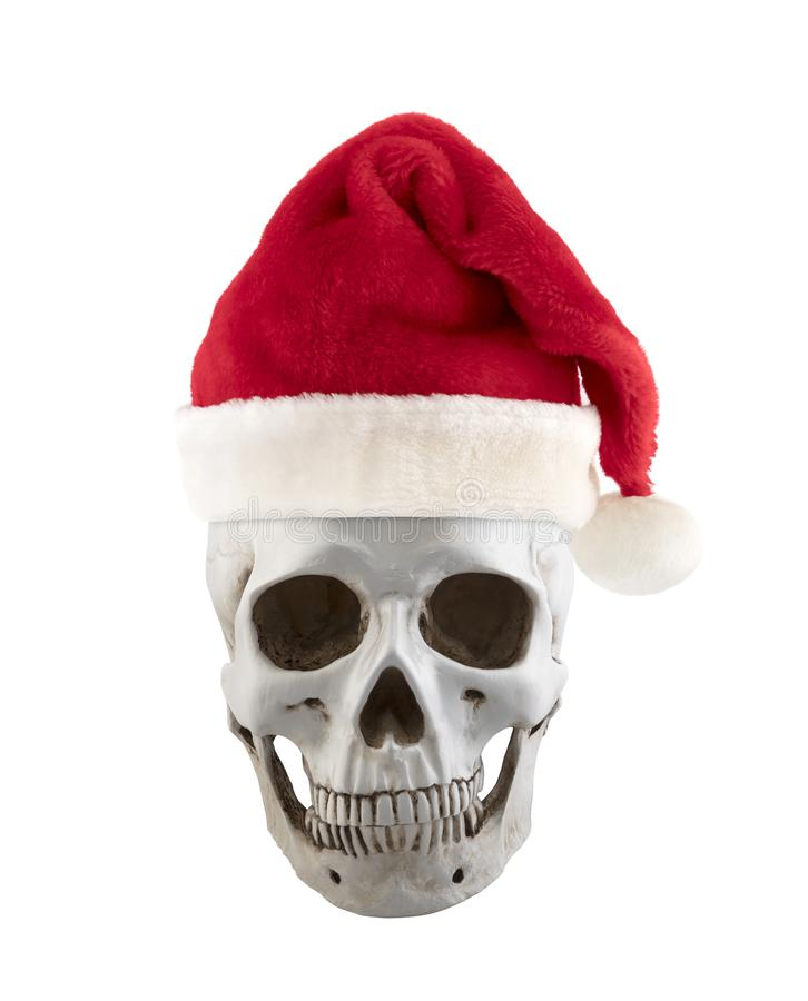 Human skull with Santa Claus red hat stock photography