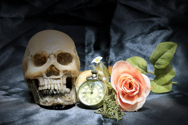 Human skull and vintage pocket watch with heart and flower on black background, Concept love and time, still life photography.  stock photo