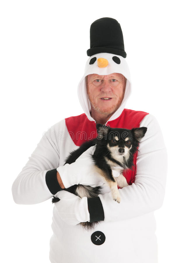 Human snowman with dog. Human snowman with little Chihuahua dog isolated over white background stock photography