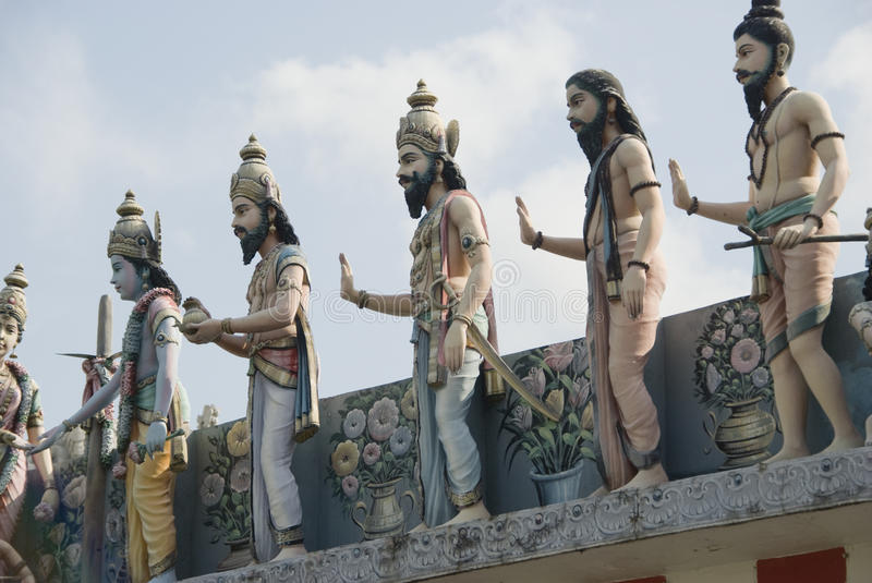 Human statues on indian temple stock photos