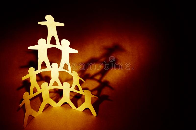 Human team pyramid. Supporting each other royalty free stock photo