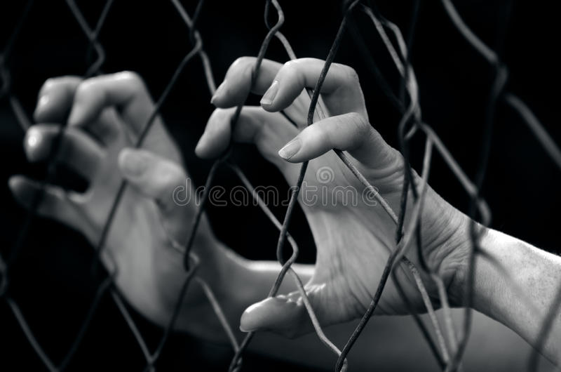 Human trafficking - Concept Photo. Hands of a missing kidnapped, abused, hostage, victim woman in emotional stress and pain, afraid, restricted, trapped, call royalty free stock photos