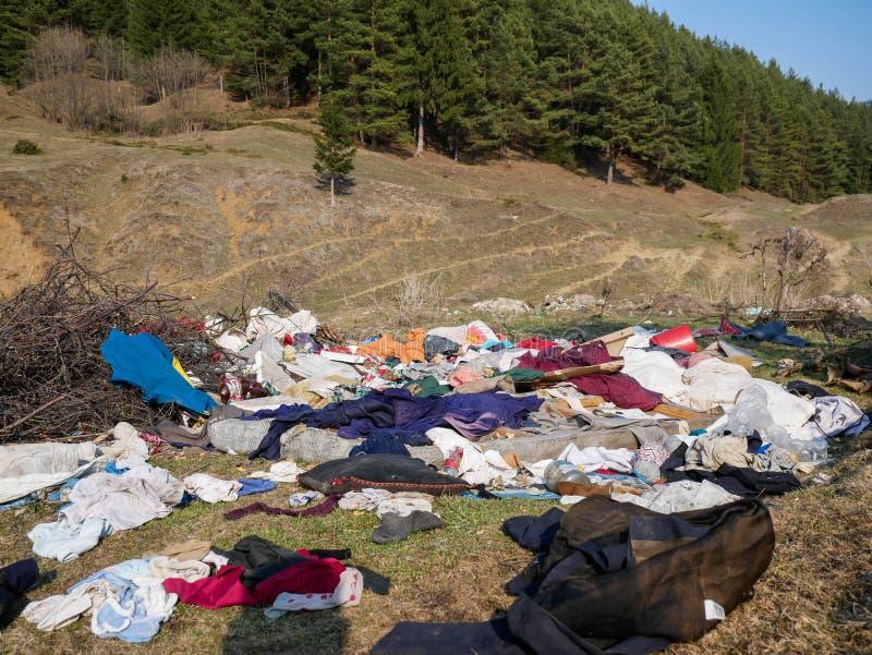 Human trash near pine forest, conceptual image of human negligence. Miercurea Ciuc, Romania-01 April 2019: Human trash near pine forest, conceptual image of stock photo
