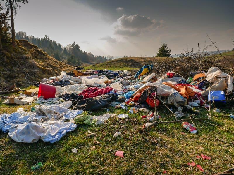 Human trash near pine forest, conceptual image of human negligence. Miercurea Ciuc, Romania-01 April 2019: Human trash near pine forest, conceptual image of stock images