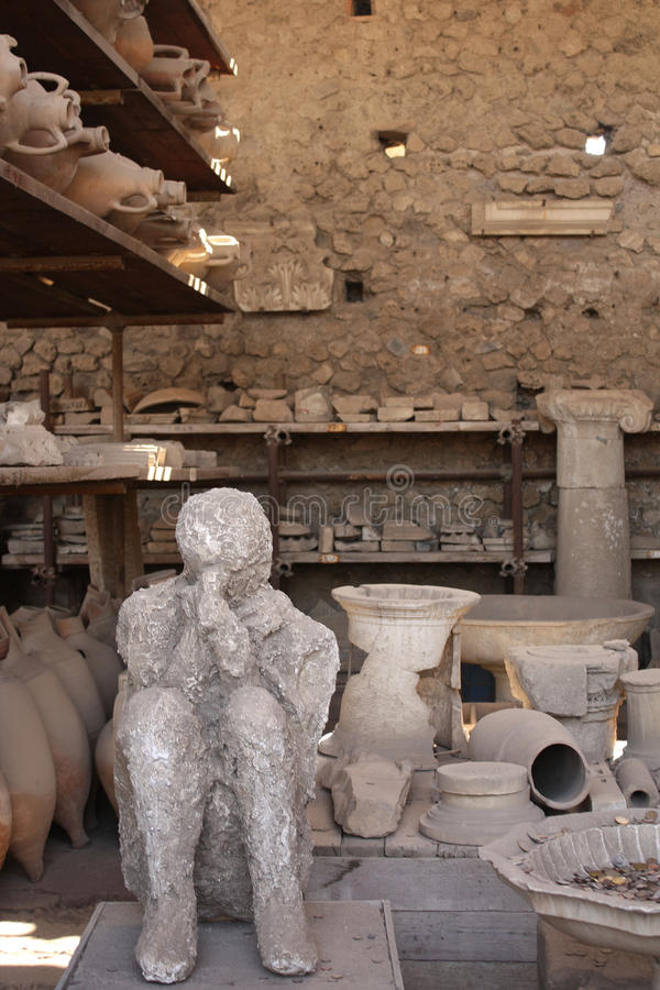 Human victim body cast and ancient amphora, Pompeii, Italy. Human victim body cast and ancient amphora in Pompeii, Italy stock photos