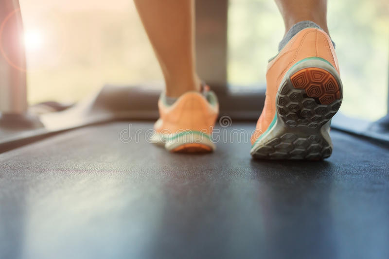 Human walking exercise on run treadmill machine cardio equipment stock image