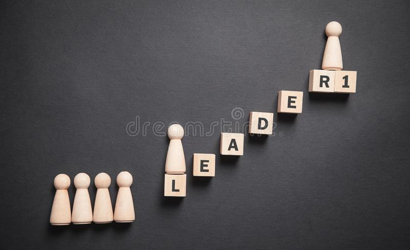 Human wooden figures with stairs. Career. Personal development. Leader stock photos