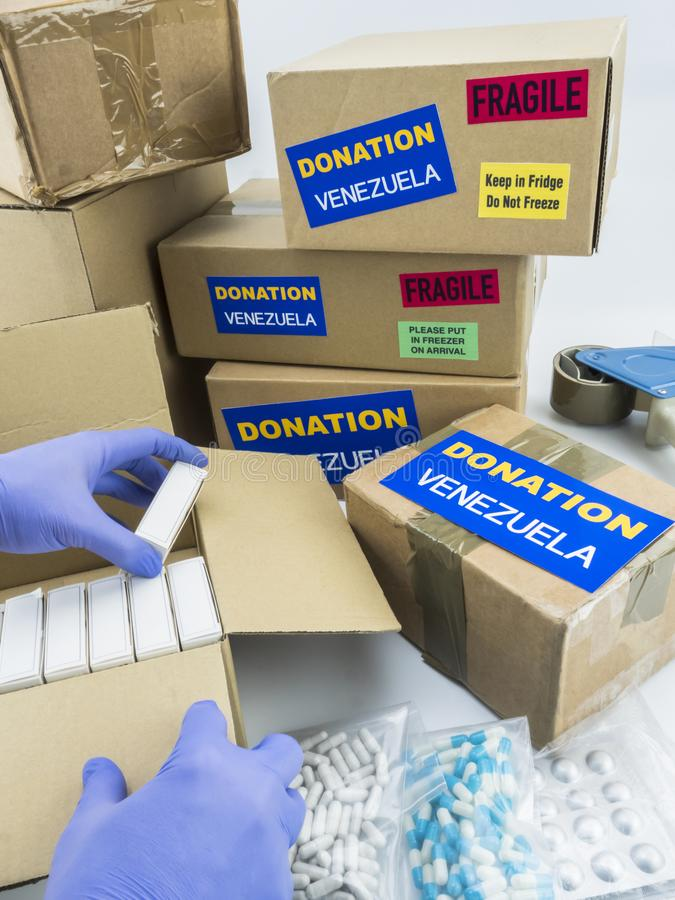 Humanitarian aid, nurse placing boxes with medication to send Venezuela. Conceptual image royalty free stock images