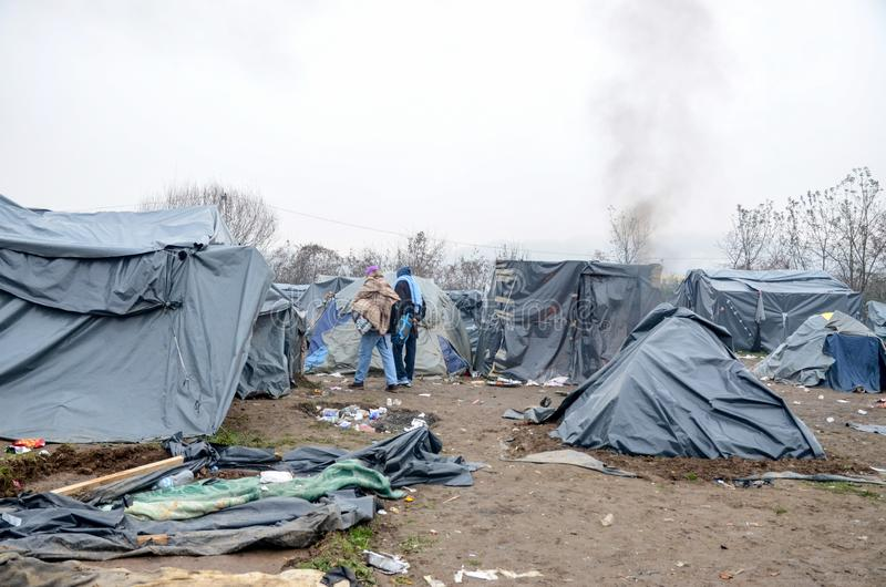 A humanitarian catastrophe in Refugee And Migrants Camp In Bosnia And Herzegovina. The European migrant crisis. Balkan Route. Tent. S in camp in Velika Kladusa stock image