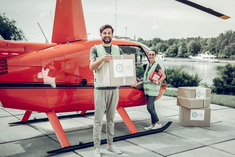 Bearded handsome humanitarian officer feeling excited while working. Humanitarian officer. Bearded handsome humanitarian officer feeling excited while working stock photo