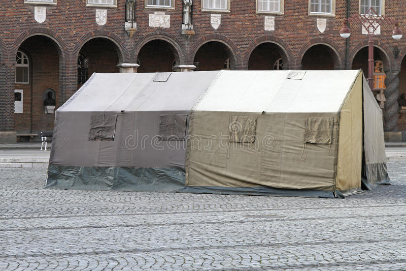 Humanitarian tent. Shelter after earthquake disaster in town royalty free stock photography