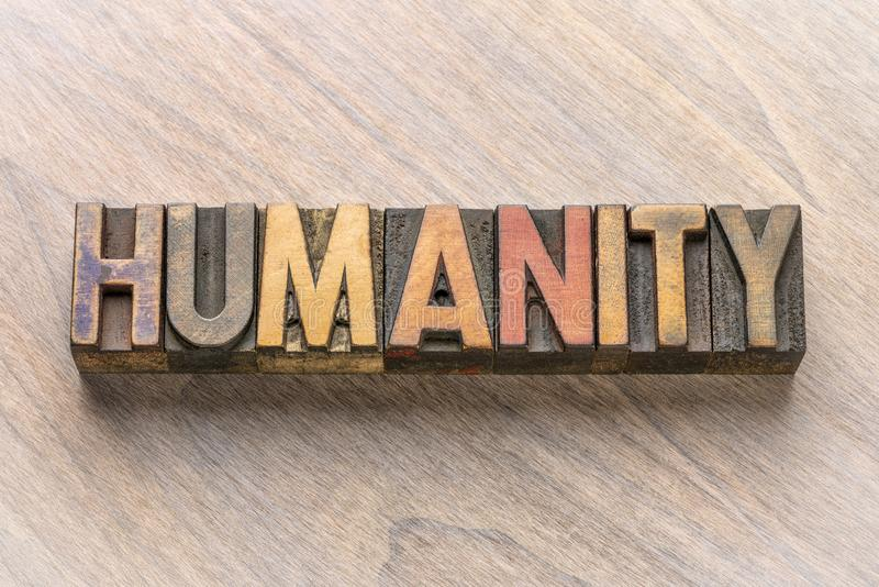 Humanity word in wood type. Humanity word in vintage letterpress wood type printing blocks stock photos