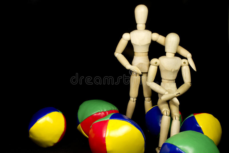Download Humanoid Couple Hugging With Juggling Balls Stock Photo - Image: 20146118