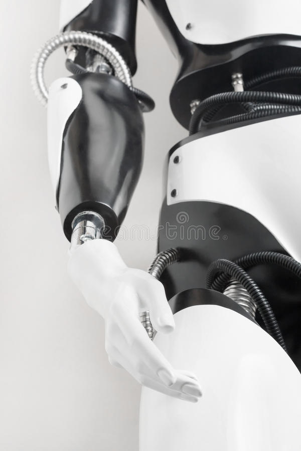 Humanoid robot body with outstretched hand. Shallow DOF. Focus on the palm of the hand royalty free stock photography