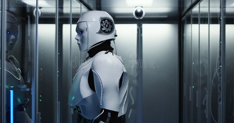Humanoid robot checking servers in a data center. Medium shot of a humanoid robot checking servers in a data center stock photo