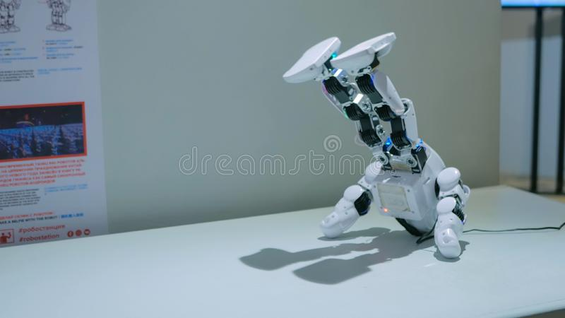 Humanoid robot dancing at robotic show. MOSCOW, RUSSIA - July 30, 2018: Robostation - future exhibition. Humanoid robot dancing at technology exhibition. Future stock photo