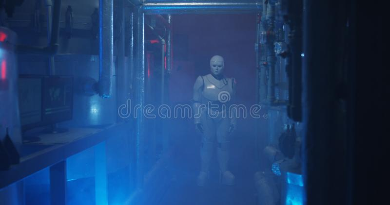 Humanoid robot standing in a dim laboratory royalty free stock photos