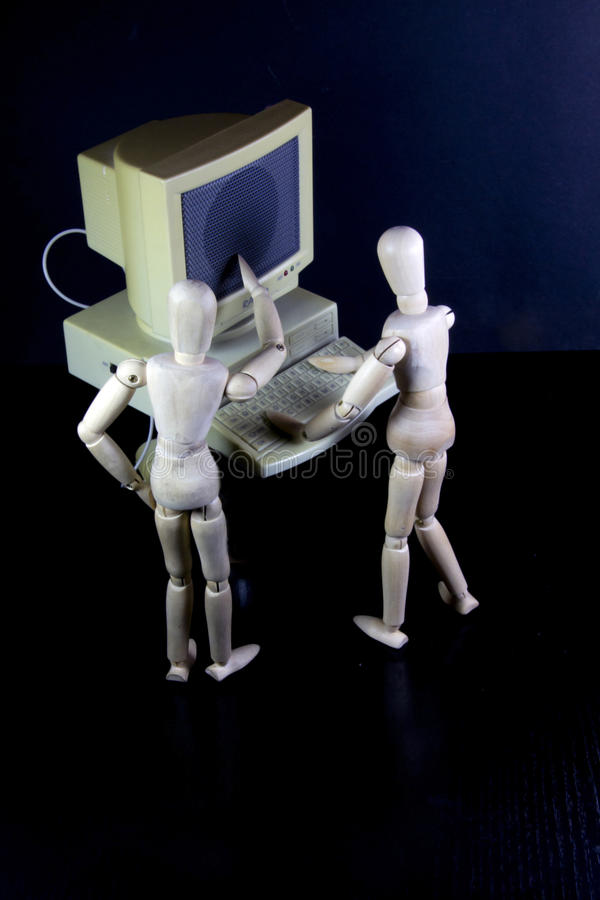 Download Humanoids Working In Teams On An Old PC Royalty Free Stock Image - Image: 22485296