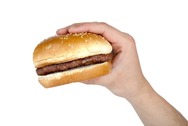 Humans hand with hamburger royalty free stock photos