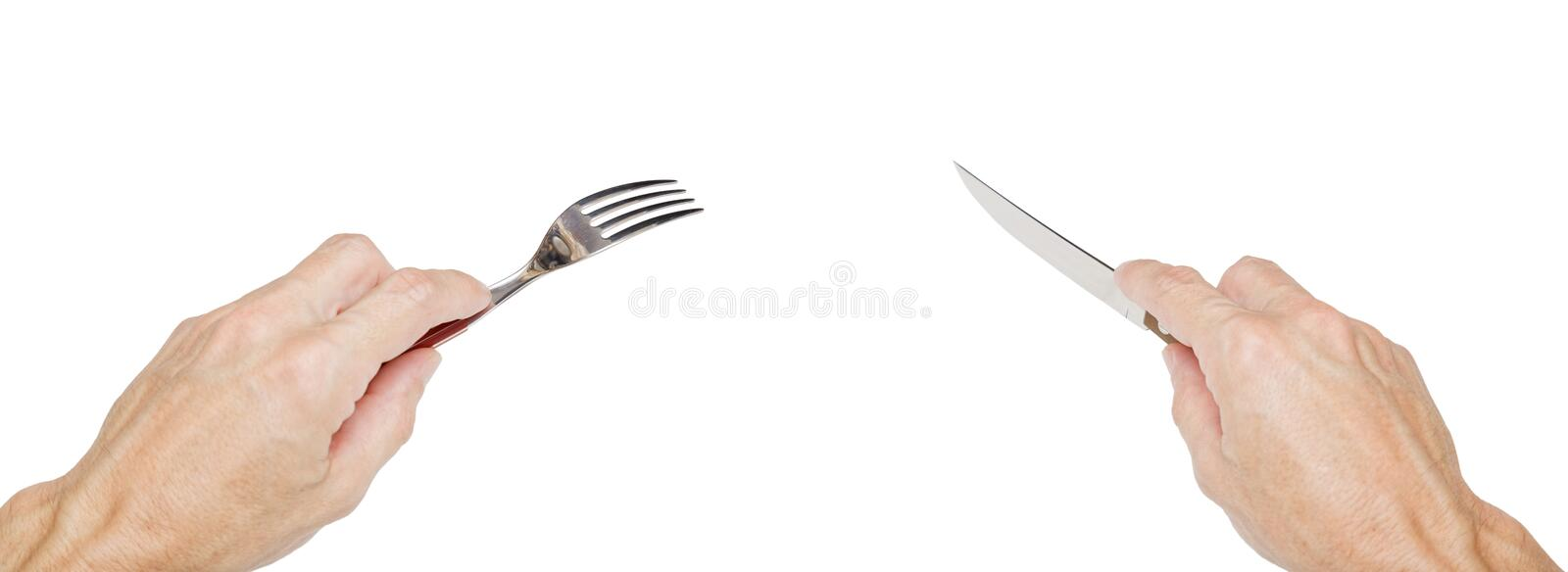 Humans hands holding a silver fork and knife. On white. Concept stock images