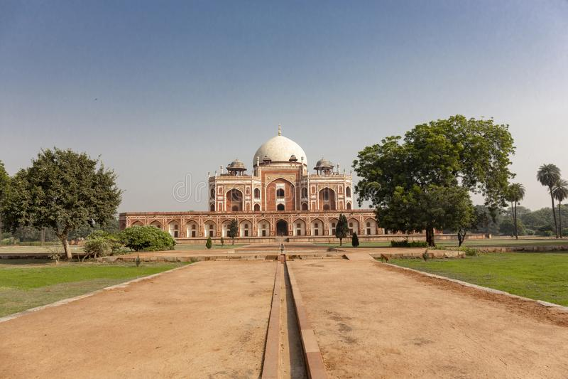 Humayun`s tomb of Mughal Emperor Humayun designed by Persian arc. Hitect Mirak Mirza Ghiyas in New Delhi, India. Tomb was commissioned by Humayun`s wife Empress stock photos