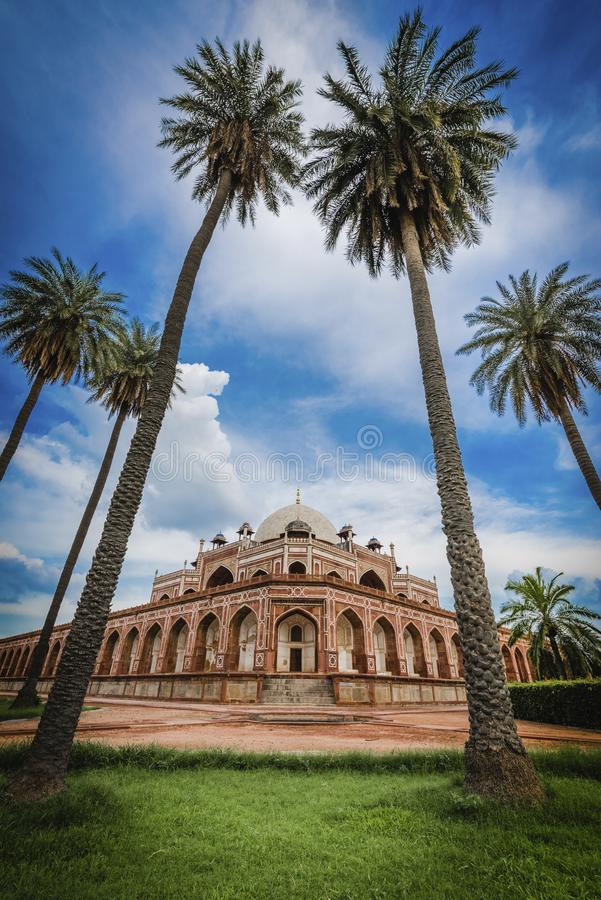 Humayun`s Tomb a world hertigate monument with palm trees. Humayun`s Tomb, Delhi, a UNESCO World Heritage moments with palm trees stock photos