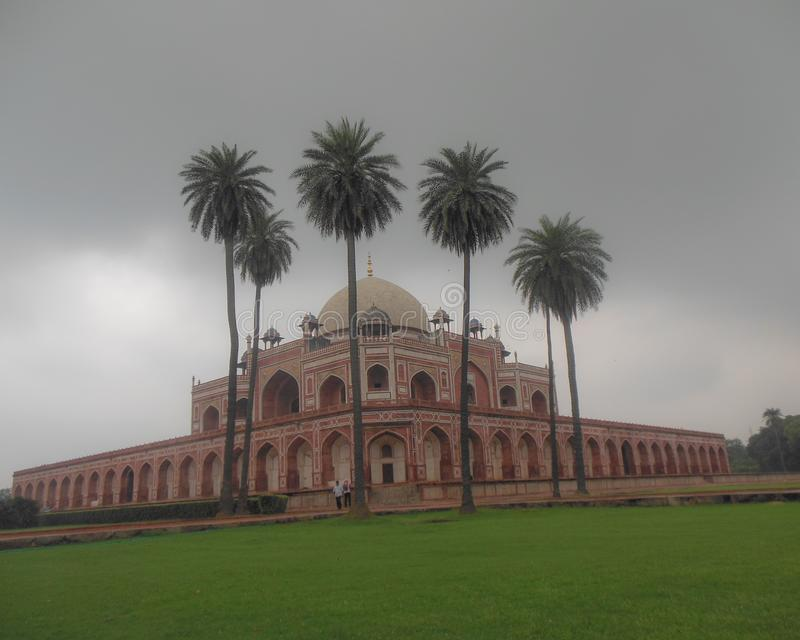 Humayun Tomb in Delhi India, Places to see in Delhi, Delhi Darshan, Humayun Tomb having clouds, humayun tomb with coconut trees. Humayun Tomb in Delhi India royalty free stock images