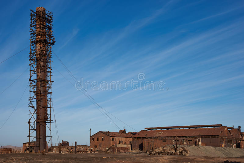 Humberstone Saltpeter Works. Derelict and rusting industrial buildings at the historic Humberstone Saltpeter Works in the Atacama Desert near Iquique in Chile stock photography