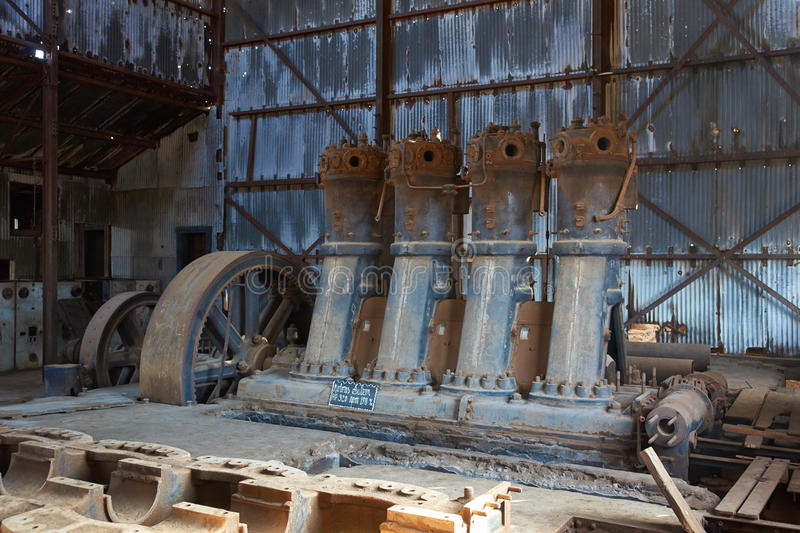 Humberstone Saltpeter Works. Derelict and rusting machinery inside a corrugated iron building at the historic Humberstone Saltpeter Works in the Atacama Desert royalty free stock images