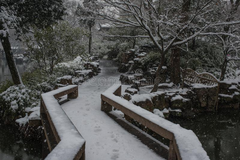 Humble Administrator`s Garden bridge in snow, ancient suzhou, china. Humble Administrator`s Garden bridge in snow winter, which is a UNESCO World Heritage Site stock images