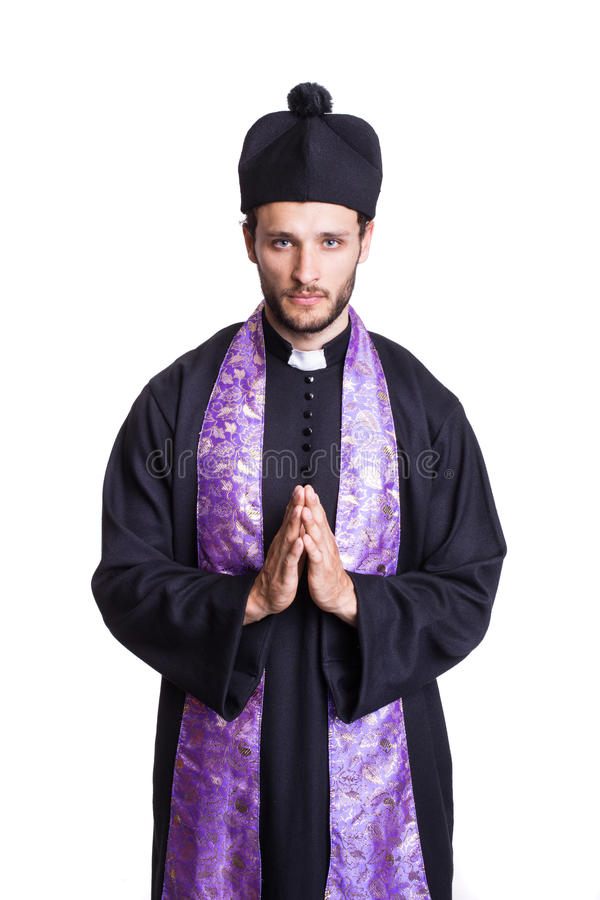 Humble Christian priest stock photography