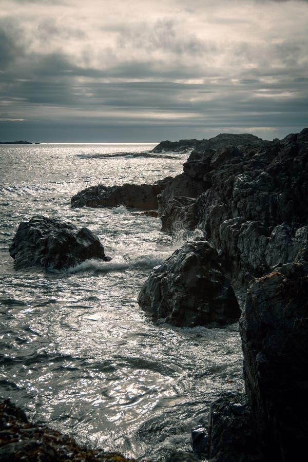 Humeurige Overzees scape bij zonsondergang royalty-vrije stock afbeeldingen