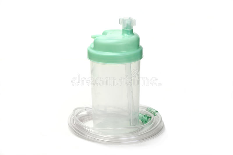 Humidifier Bottle. Oxygen therapy system humidifier bottle with tubing stock image